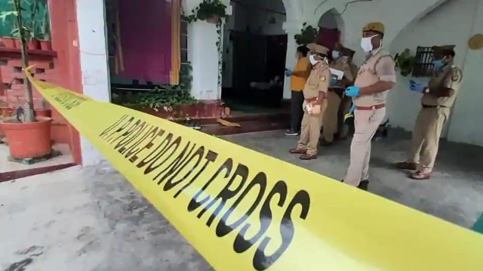 Police at the scene of crime in Lucknow.