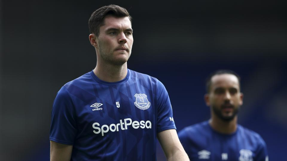 Everton's Michael Keane, left, and Theo Walcott arrive for the English Premier League soccer match between Everton and Bournemouth at Goodison Park in Liverpool, England Sunday, July 26, 2020. (Tim Goode/Pool via AP)