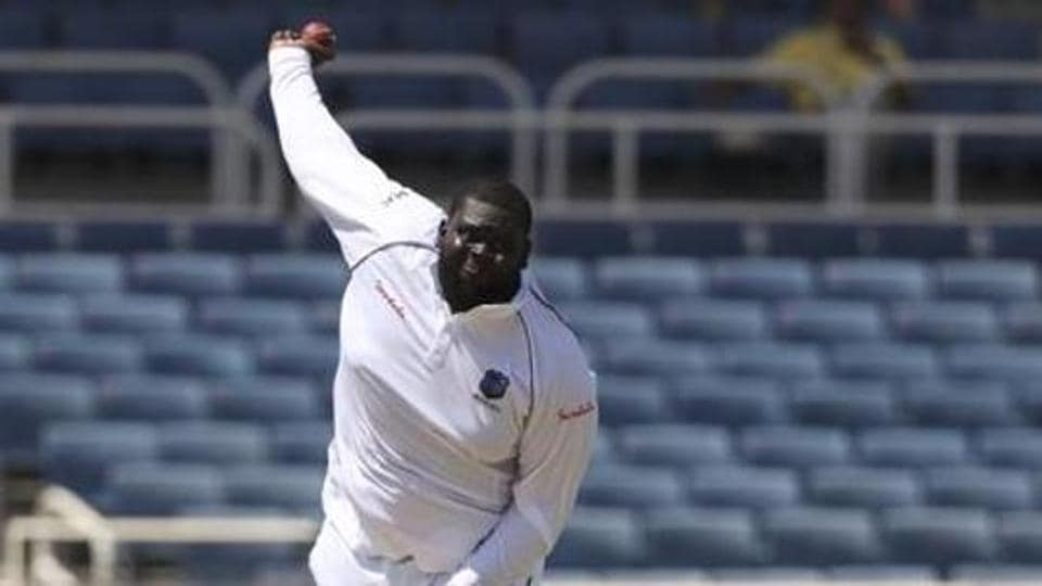 West Indies' RahkeemCornwall bowls against India during day one of the second Test cricket match at Sabina Park cricket ground in Kingston, Jamaica Friday, Aug. 30, 2019. (AP Photo/Ricardo Mazalan)