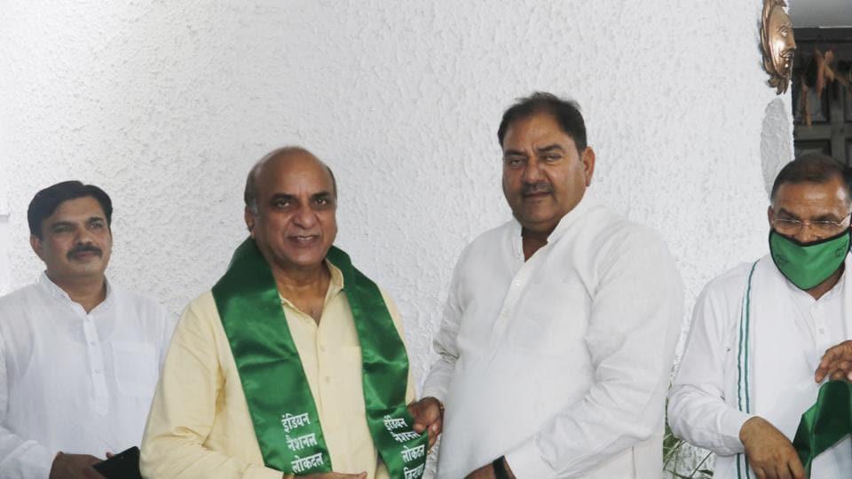 Raj Kumar Balmiki with INLD leader Abhay Chautala on Sunday.
