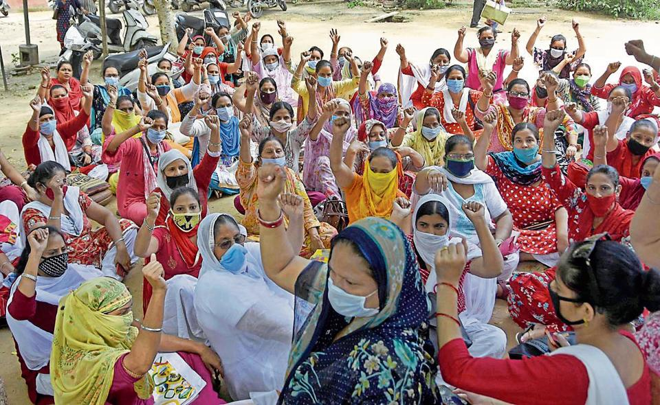 Anganwadi workers staging a protest against the state government outside the office of district programme officer in Shimlapuri on Monday