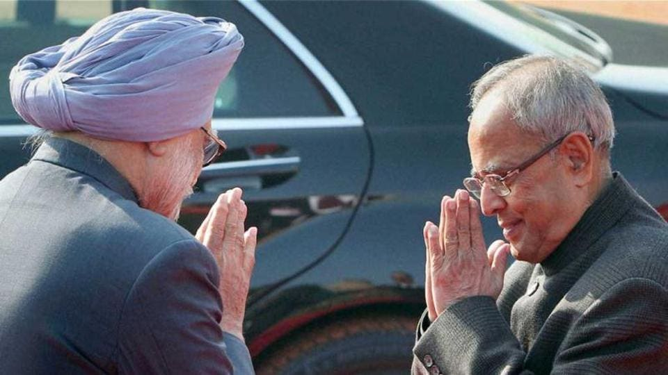 President Pranab Mukherjee and Prime Minister Manmohan Singh leave after a ceremonial reception at the Rashtrapati Bhawan in New Delhi.