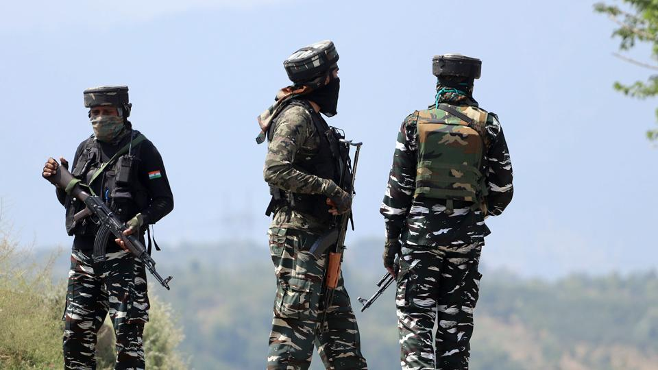 Security personnel stand guard near the encounter site in Baramulla.