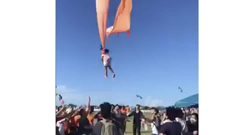 In this image made from video, a 3-year-old girl is lifted into the air by a large kite during a kite festival in Hsinchu, northern Taiwan.