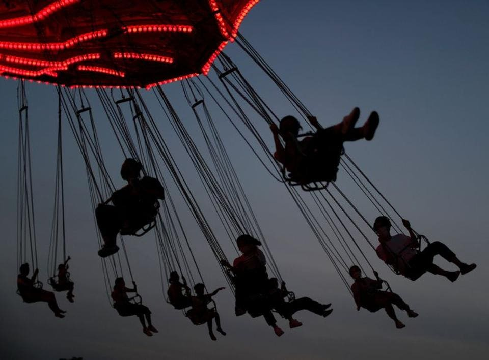 Visitors enjoy an attraction, amid the coronavirus disease (COVID-19) outbreak, at Toshimaen amusement park which will close 94 years after it first opened with part of the site to be turned into a new Harry Potter theme park in 2023, in Tokyo, Japan August 9, 2020.  (REUTERS/Issei Kato)