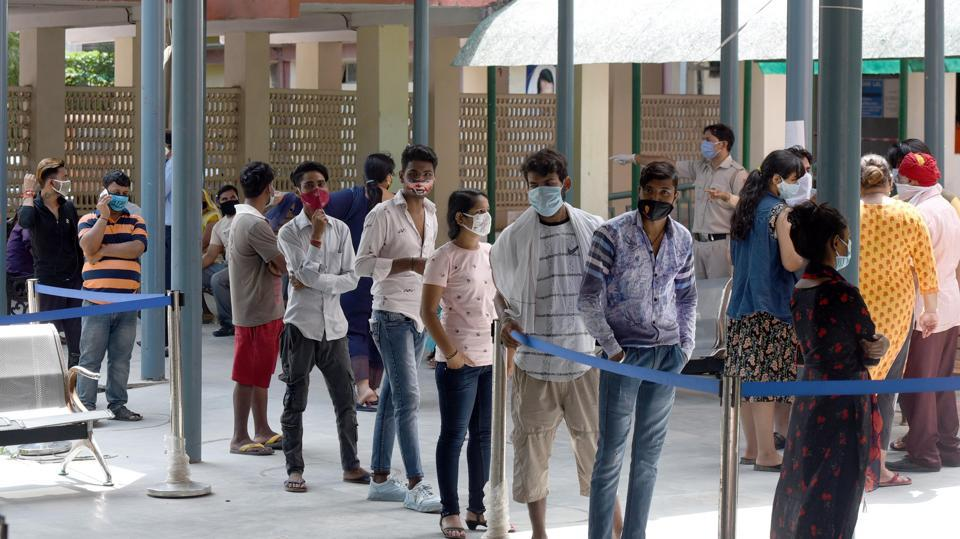 People wait their turns for coronavirus testing at Nehru Homoeopathic Medical College and Hospital in New Delhi on August 31. The positivity rate – the percentage of people who test positive for the virus of those overall who have been tested – has also been increasing over the last two weeks. Delhi has recorded a seven-day average positivity rate of 8.9%, with a one-day high of 9.9% on August 30. (Sonu Mehta / HT Photo)
