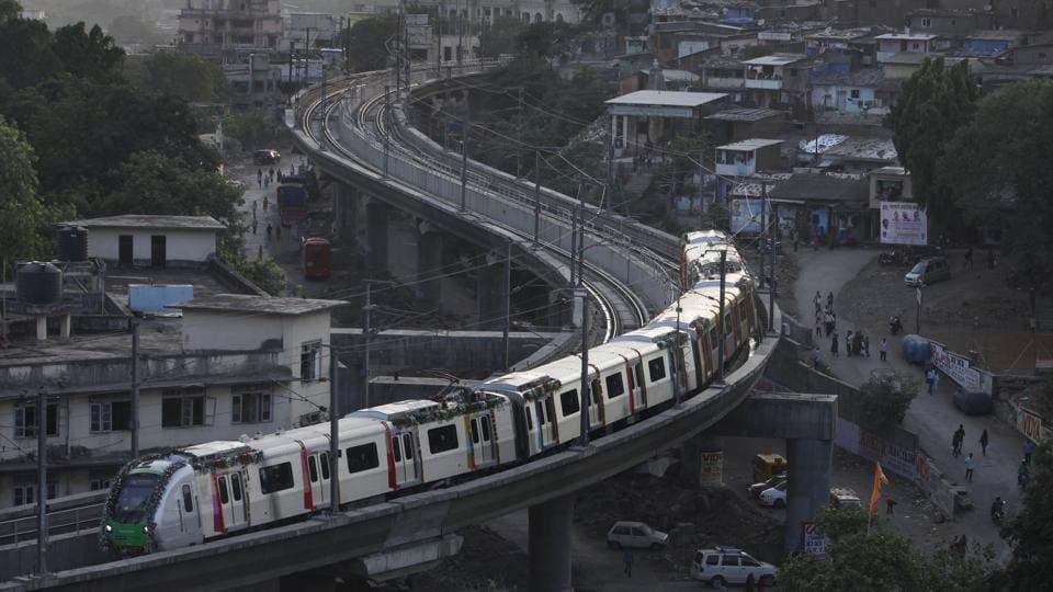 Mumbai, India, June 08, 2014: A Mumbai metro train runs on the first day of commencing operations at Ghatkopar in Mumbai, India on Sunday, June 08, 2014. (Kunal Patil/Hindustan Times)