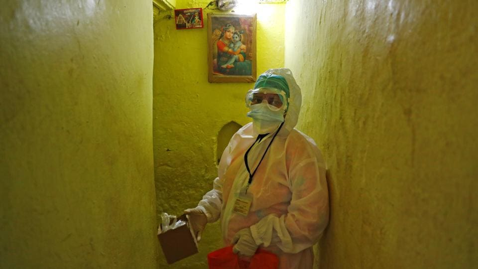 "A health worker standing in a hallway holds a box containing a pulse oximeter collected from a coronavirus infected person in New Delhi on August 26. ""With how densely populated we are the absolute numbers are going to be huge. But what is encouraging is that our CFR (case fatality ratio) is close to 2%,"" Dr Jugal Kishore, HoD Community Medicine, Safdarjung Hospital told HT while commenting on the rising cases. (Adnan Abidi / REUTERS)"
