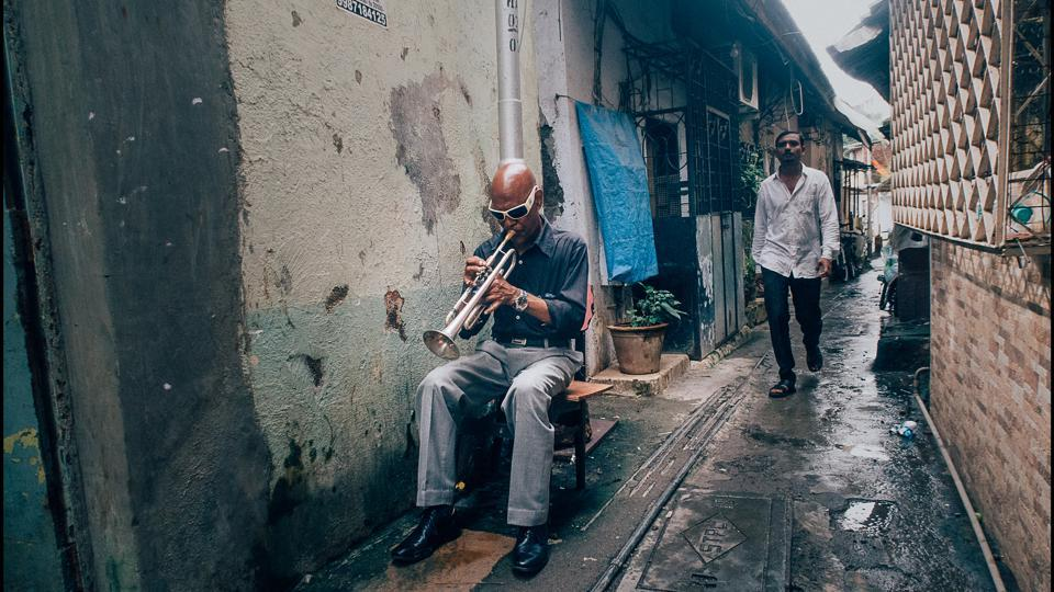 A musician plays in a narrow alley, just off Bazzar Street in Bandra, Mumbai. (Gopal MS)