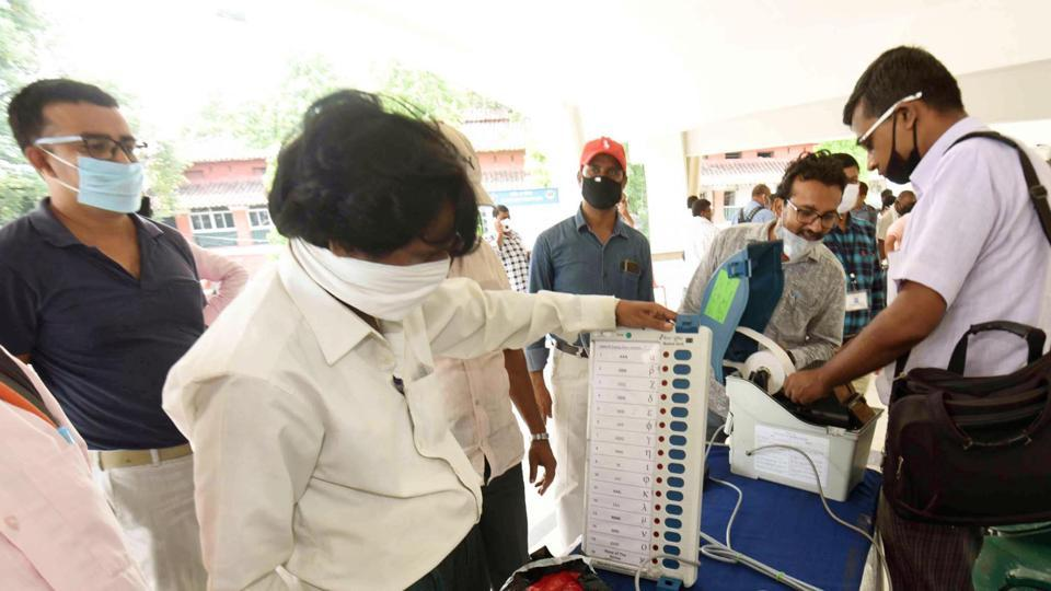 Election officials demonstrates the function of Electronic Voting Machine (EVM) and Voter-Verified Paper Audit Trail (VVPAT) during a training programme ahead of Bihar Assembly Elections at S.K. Memorial hall in Patna.