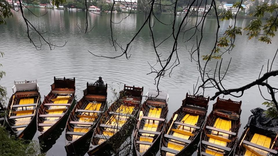 Empty boats at Naini Lake in Nainital tell the story of  the absence lack of tourists amid the Covid-9 pandemic.