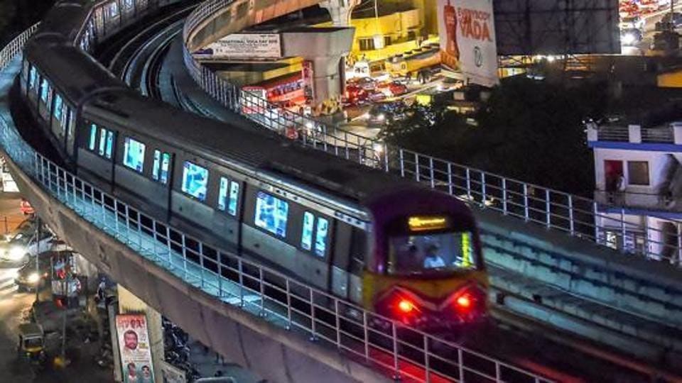 A six-coach Namma Metro runs on a track after its inauguration in June 2018.