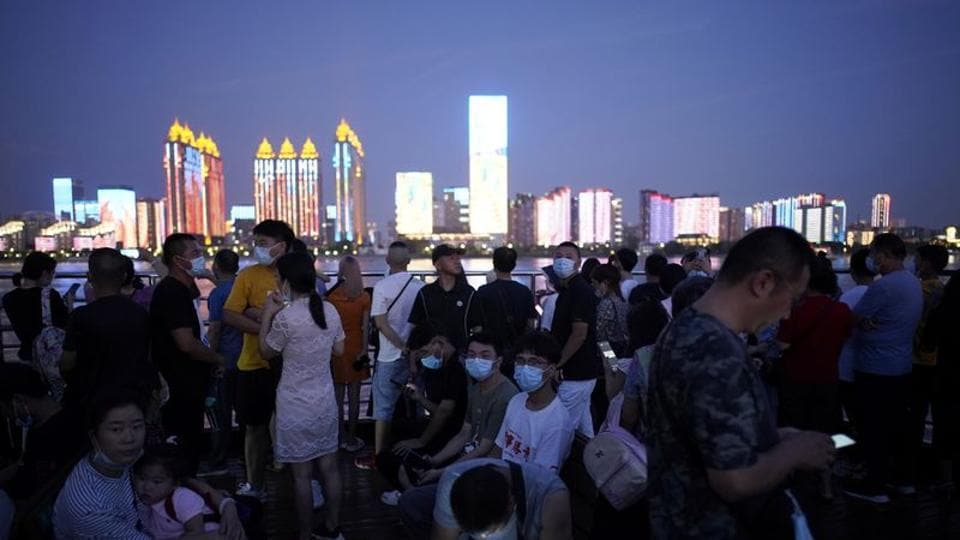 China tries to flip the pandemic script, starring a 'reborn' Wuhan