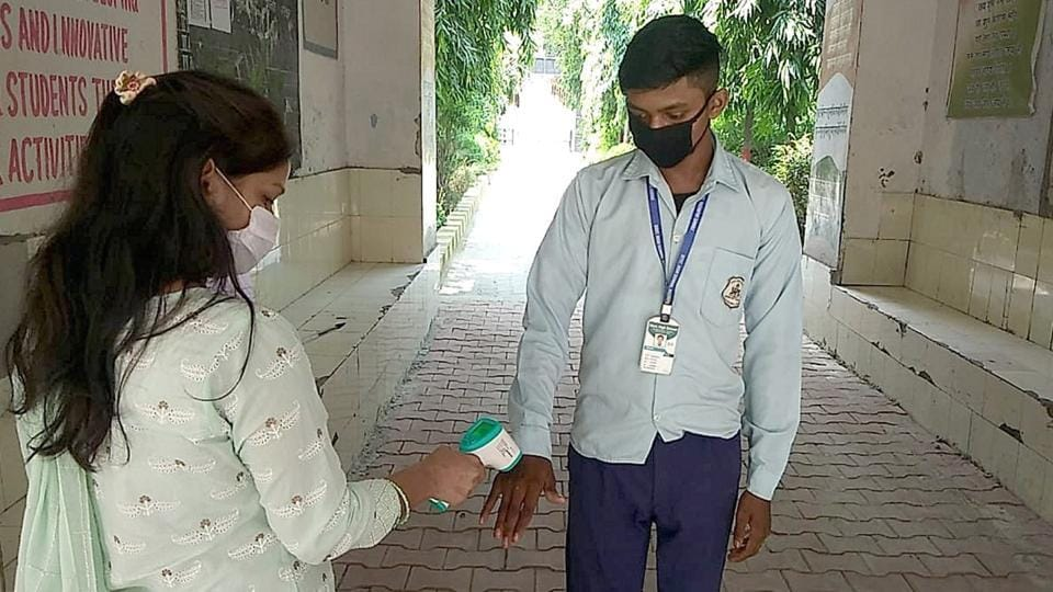 A student 's temperature being checked before he enters his classroom at Government High School, Bazidpur,  in Sonepat district on Monday. It was one of the two government schools in Haryana that reopened on September 7 for students of Classes 10 and 12 for the first time since March-end when the Covid-19 pandemic broke out in the country.