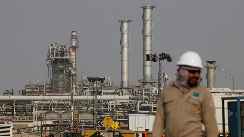 An employee looks on at a Saudi Aramco oil facility in Abqaiq, Saudi Arabia.