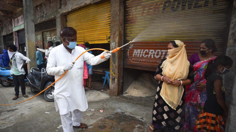 A man sprays sanitiser at Jahangirpuri in New Delhi on Tuesday.