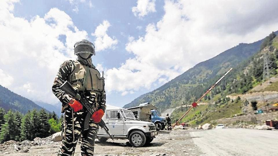 A Central Reserve Police Force (CRPF) personnel stands guard at a checkpoint along a highway leading to Ladakh, Ganderbal, Kashmir, September 2, 2020