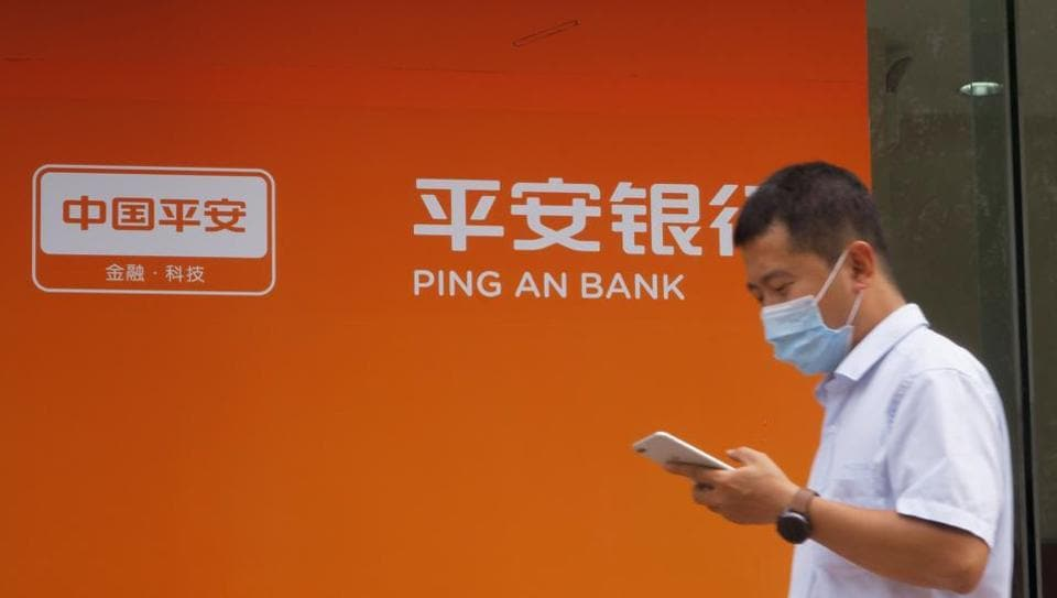 A man walks past a branch of Ping An Bank, a subsidiary of Ping An Insurance, in Beijing, China.