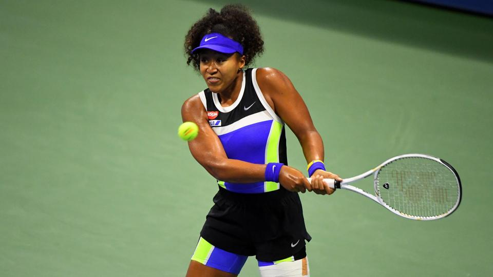 Naomi Osaka of Japan returns the ball against Shelby Rogers of the United States in the women's singles quarter-finals match on day nine of the 2020 U.S. Open tennis tournament at USTA Billie Jean King National Tennis Center.