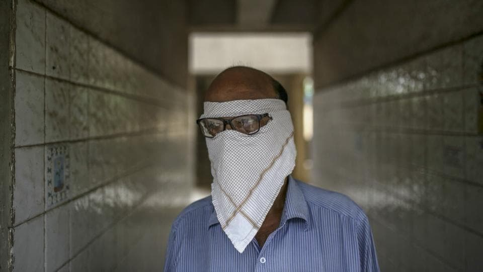 A man with a face cover stands in a corridor in Boisar on September 6. With India's coronavirus tally crossing the 43 lakh-mark in the previous 24-hour period, the Union Health Ministry on September 9 said that 60% of the total cases stem from the five worst-affected states, adding that of the cases in the last 24 hours, over 20,000 are from Maharashtra alone. (Dhiraj Singh / Bloomberg)