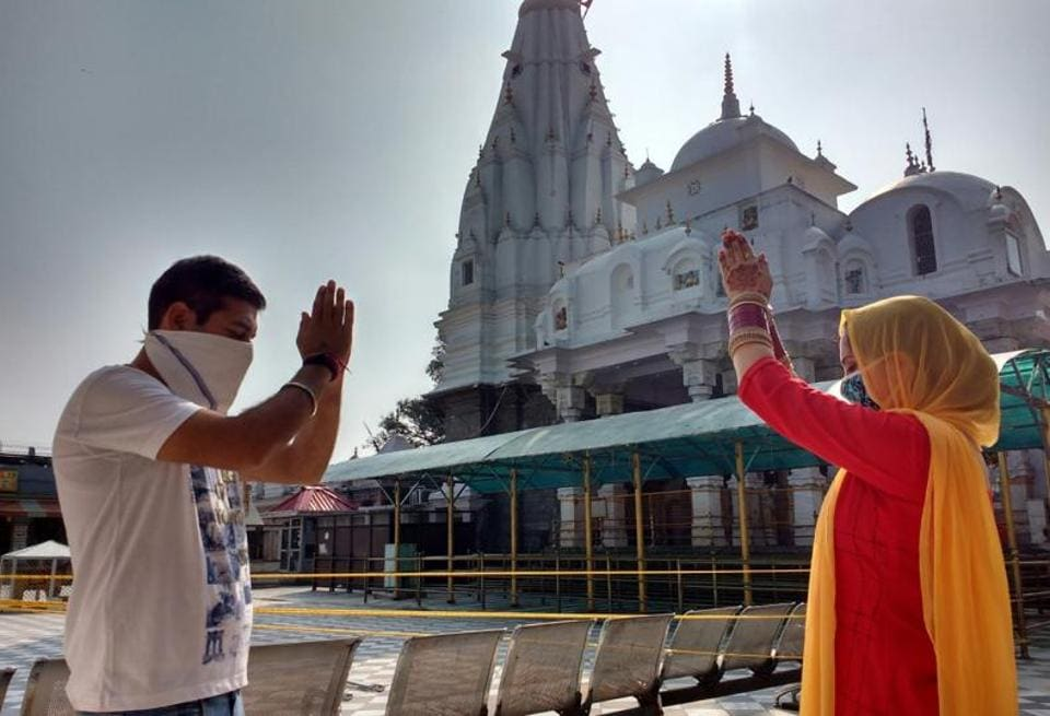 A couple offering prayers at the Brajeshwari Temple in Kangra on Thursday morning. Temples in Una, Bilaspur and Hamirpur districts were also opened after five months.