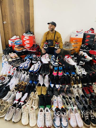 'It's like the stock market, value based on perception,' says Sharma, seen here with some of his 150 pairs of sneakers.