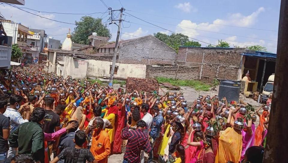 The kalash yatras drew large crowds incomplete violation of Covid-19  protocol.