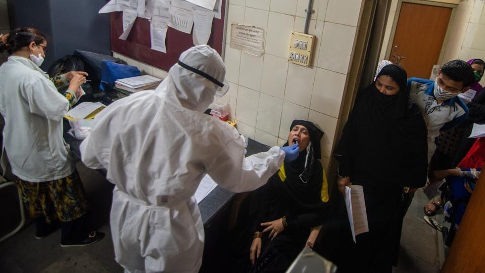 Health care worker during Covid-19 Swab testing camp inside a Municipal dispensary at Baiganwadi, Govandi in Mumbai.