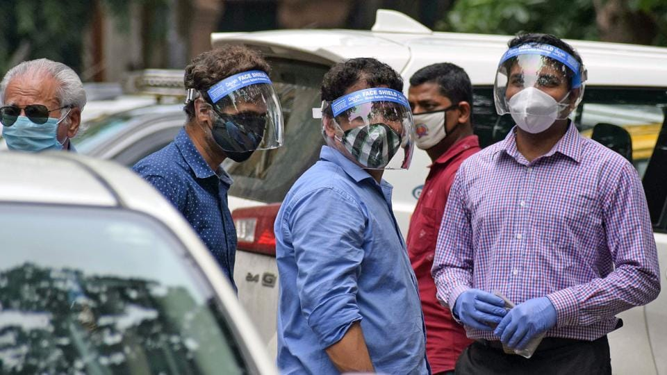 Mumbaikar wearing a face shieldand mask as a preventive measure to Covid-19 at Ballard Pier, in Mumbai.