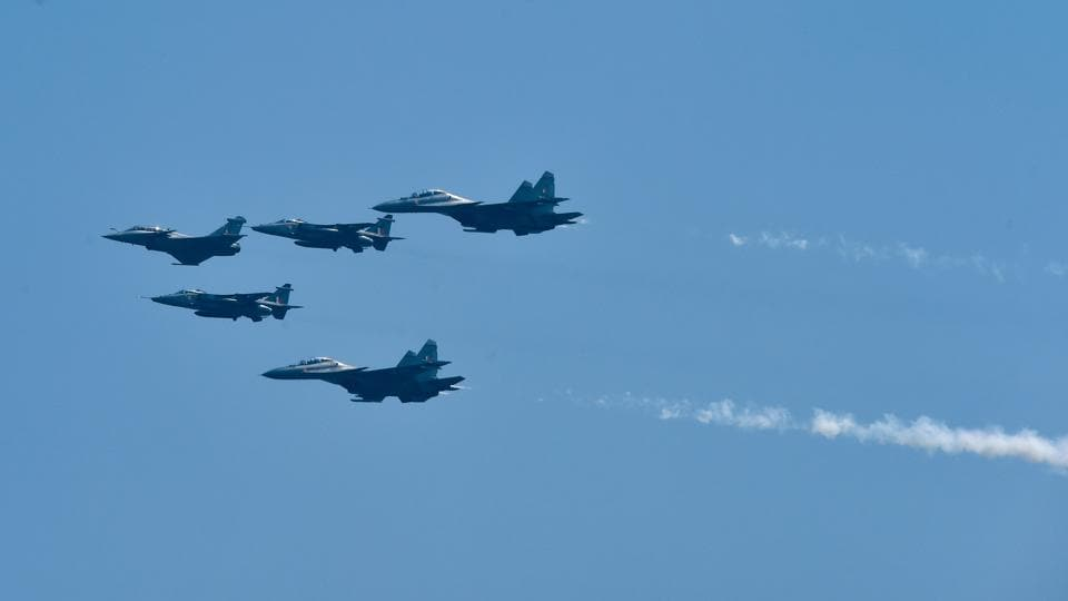 Air display of the first batch of IAF's Rafale aircraft in an arrow formation followed by Jaguar and SU-30 aircraft during the former's induction ceremony, in Ambala.