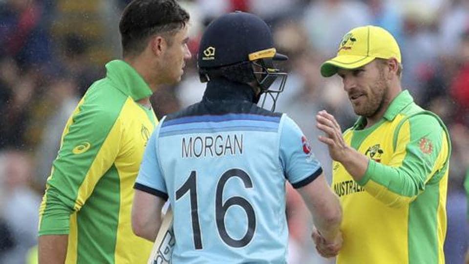 England's captain Eoin Morgan, center, shakes hands with Australia's captain Aaron Finch.