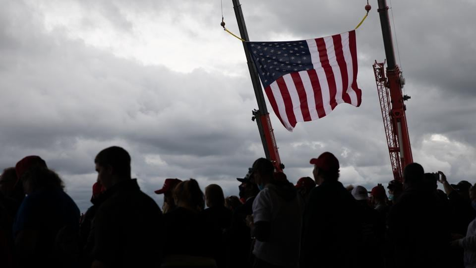 An American Flag hangs on display ahead a campaign rally with U.S. President Donald Trump in Freeland, Michigan, US (Bloomberg)