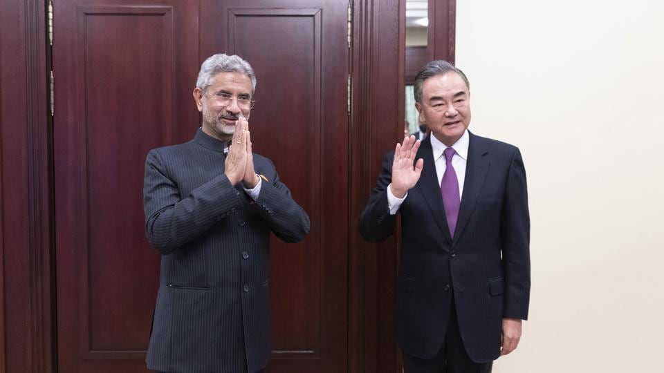 External affairs minister S Jaishankar and Chinese foreign minister Wang Yi pose for a photo as they meet on the sidelines of a meeting of the foreign ministers of the Shanghai Cooperation Organization in Moscow on Thursday.