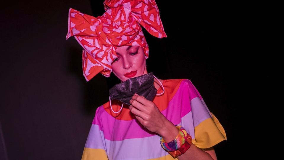 A model holds a face mask prior the fashion show of Spanish designer Agatha Ruiz de la Prada during the Mercedes-Benz Fashion Week in Madrid, Spain, Thursday, Sept. 10, 2020. The Spanish fashion week takes place from 10 to 13 September under new security measures and social distance guidelines due the coronavirus pandemic.