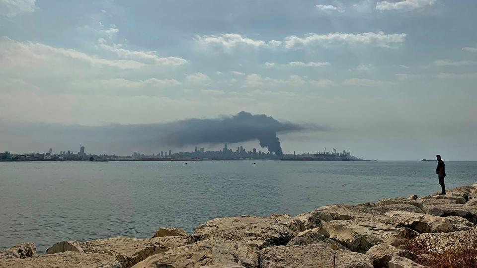 A plume of smoke rises into the sky from a huge fire raging at the port in the Lebanese capital of Beirut as seen from Dbayeh, north of Beirut on September 10. Thick black columns of smoke rose high, as the army said it a fire had engulfed a warehouse storing engine oil and vehicle tyres. (Joseph Eid / AFP)