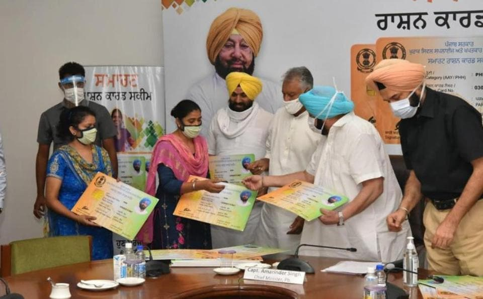 In a symbolic gesture, Punjab chief minister Capt Amarinder Singh handed over the smart ration cards to four beneficiaries at the Secretariat in Chandigarh, after which ministers and MLAs distributed cards in their respective districts and constituencies.
