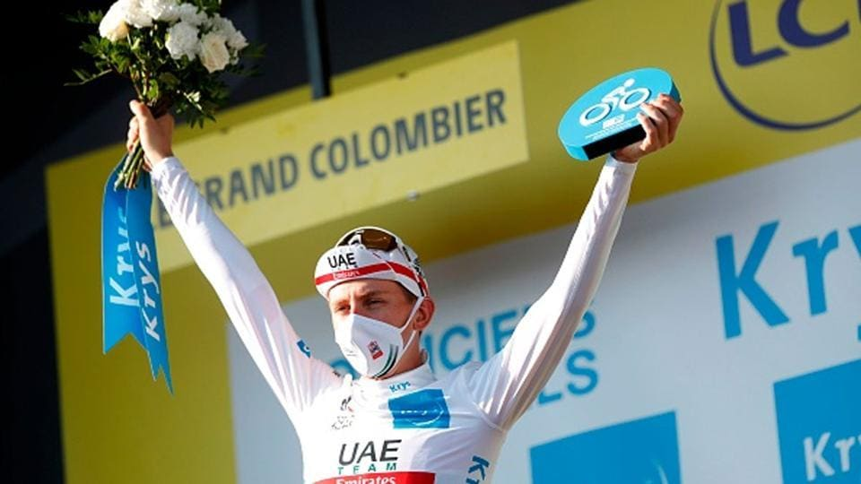 Stage winner Team UAE Emirates rider Slovenia's Tadej Pogacar celebrates on the podium after winning the 15th stage of the 107th edition of the Tour de France cycling race