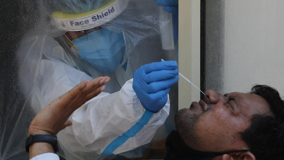 A health worker takes a nasal swab sample to test for Covid-19 in New Delhi on Saturday.