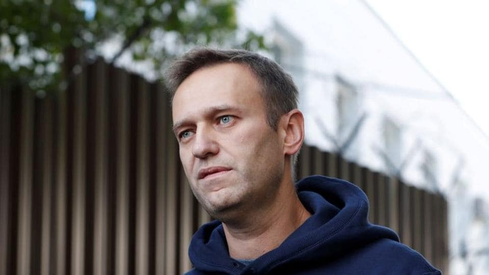 Russian opposition leader Alexei Navalny speaks with journalists after he was released from a detention centre in Moscow, Russia.