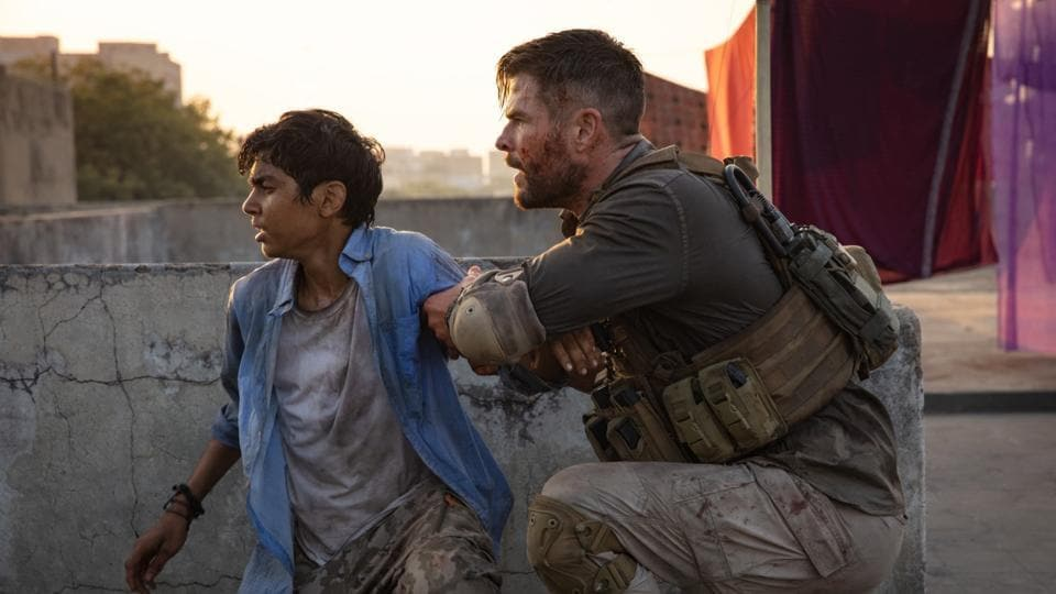 Rudhraksh Jaiswal and Chris Hemsworth in a still from Extraction.
