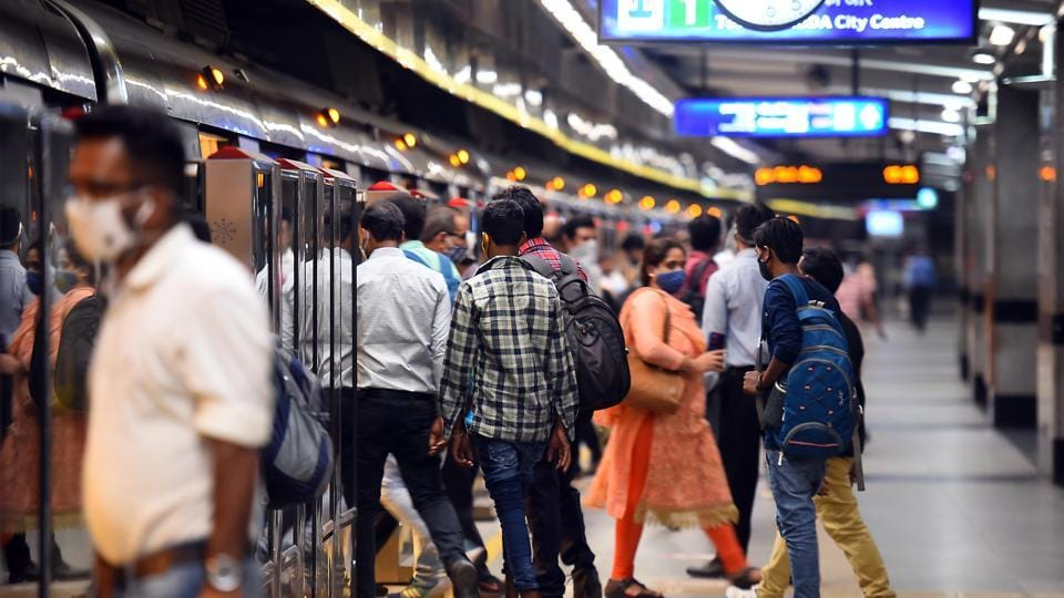 Passengers wear masks while using metro services during Unlock 4, at Rajiv Chowk metro station, in New Delhi.