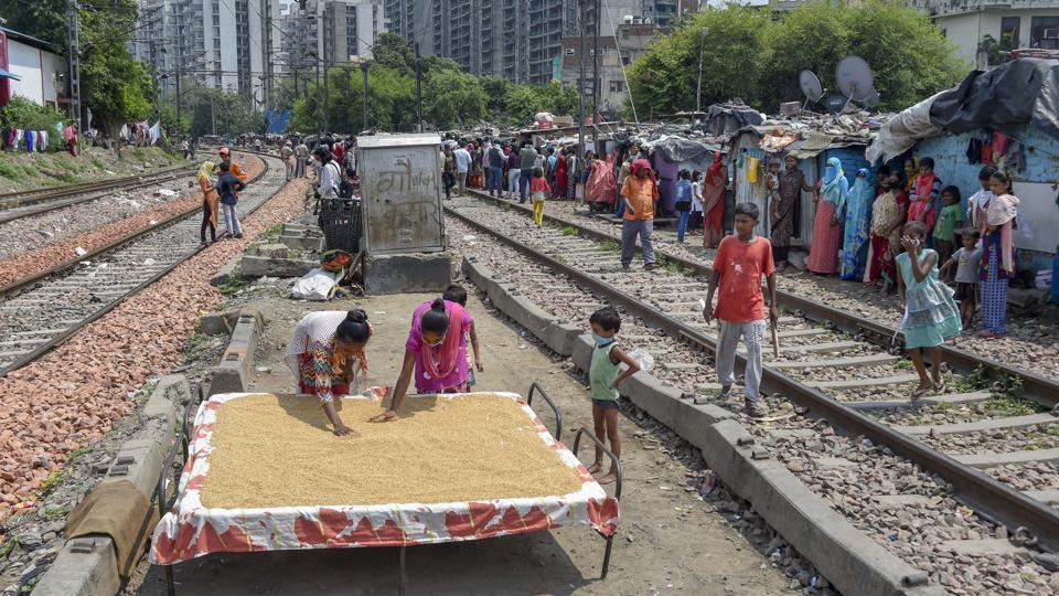 Residents of a slum near Sarai Rohilla Railway Station in New Delhi.