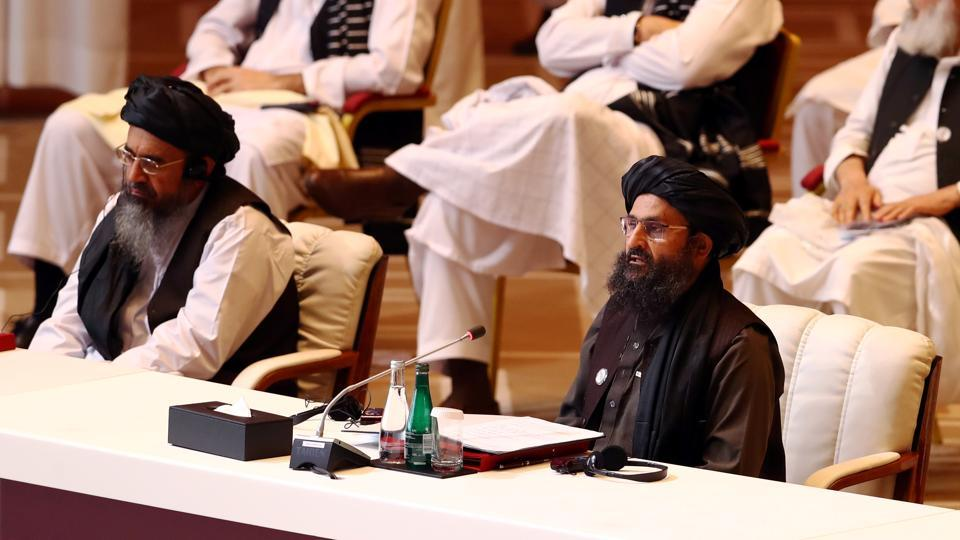 Mullah Abdul Ghani Baradar, the leader of the Taliban delegation, speaks during talks between the Afghan government and Taliban insurgents in Doha, Qatar on Sunday