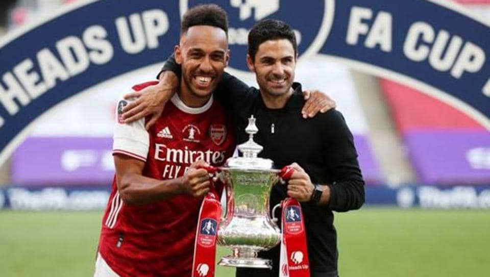Arsenal manager Mikel Arteta and Pierre-Emerick Aubameyang celebrate with the trophy after winning the FA Cup.