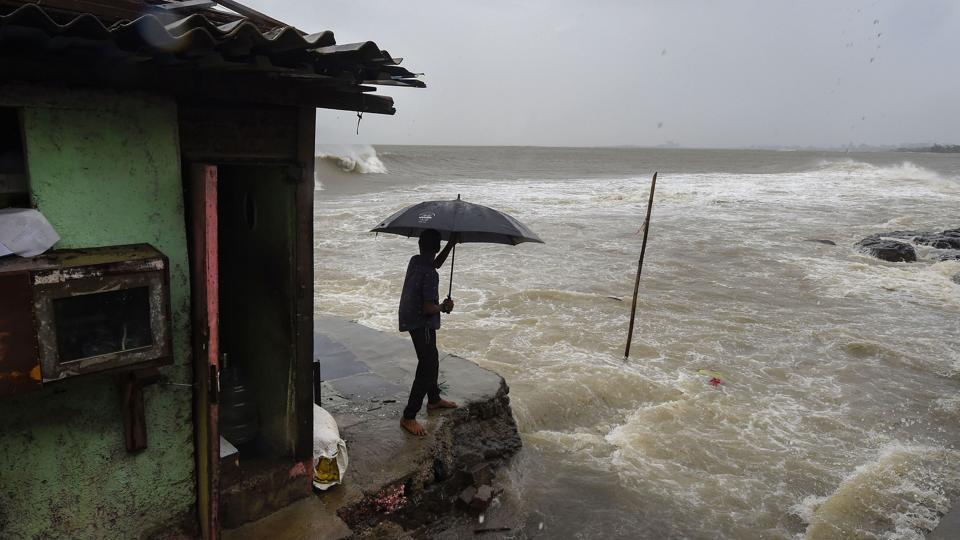 A man standing near a shanty built on the edge of the Arabian Sea at Bandra, as the waves turned choppy ahead of Cyclone Nisarga's expected landfall in Mumbai on June 3, 2020.