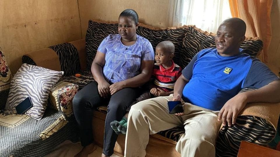 Five-year-old Miguel Munene sits between his parents Patrick Nyaga and Celestine Wanjiru, as he watches characters from a cartoon made by Tanzanian non-profit Ubongo, which offers television and radio content for free to African broadcasters in Nairobi, Kenya August 29, 2020.