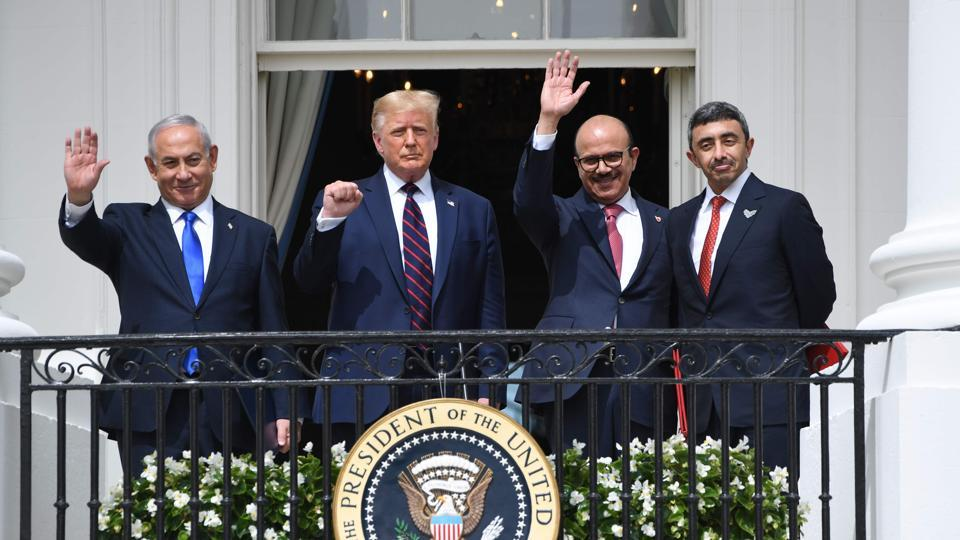 (From left to right) Israeli Prime Minister Benjamin Netanyahu, US President Donald Trump, Bahrain Foreign Minister Abdullatif al-Zayani, and UAE Foreign Minister Abdullah bin Zayed Al-Nahyan wave from the Truman Balcony at the White House after they participated in the signing of the Abraham Accords where the countries of Bahrain and the United Arab Emirates recognize Israel.