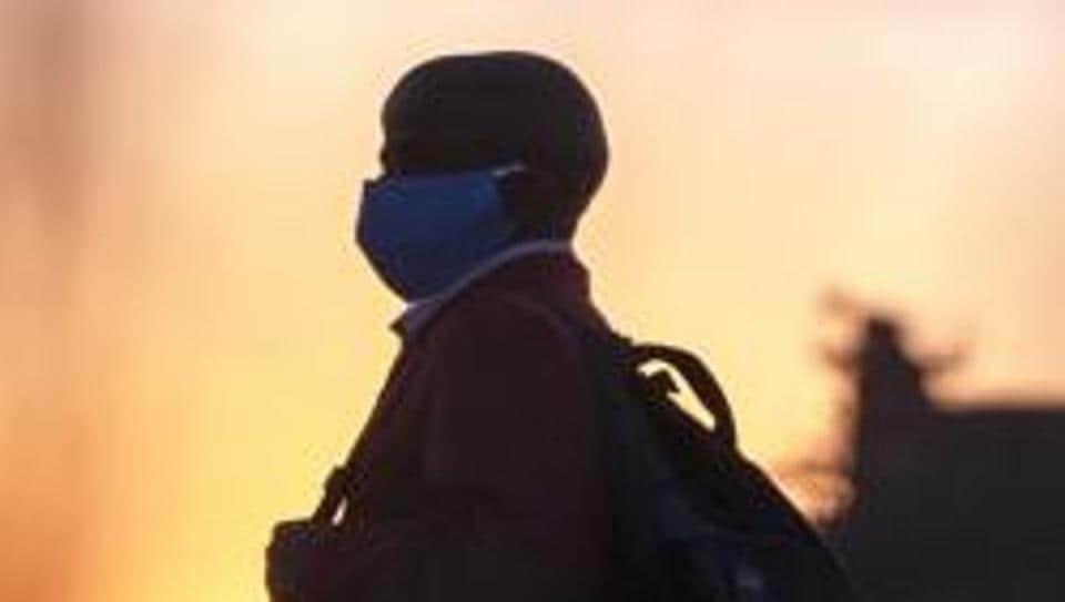 A man wearing protective masks to help curb the spread of the coronavirus