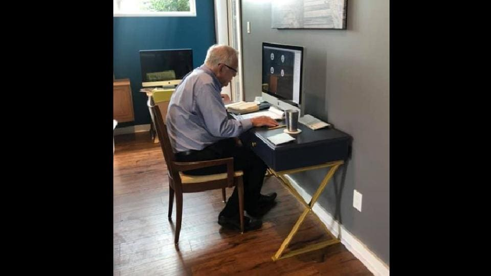 The image shows the 91-year-old sitting in front of a computer.