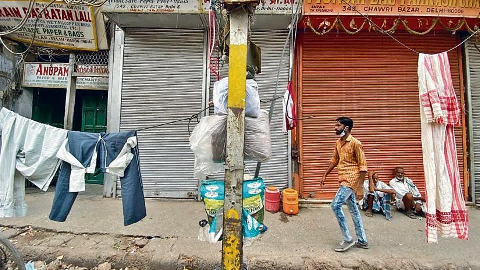 The more visible use of these cables (the ones in plastic coverings) is as clothes hangers for the hundreds of daily wage labourers of Chawri Bazar. Mostly single men with families back in the villages, the labourers tend to live in groups.